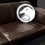 Shadow Crow Head Pillow - On couch